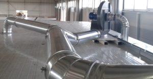 Applicazione 1: tubazione sistema aspirazione-pulizia cabina taglierina. Convogliamento al filtro